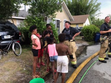 Firefighter speaks to neighborhood children