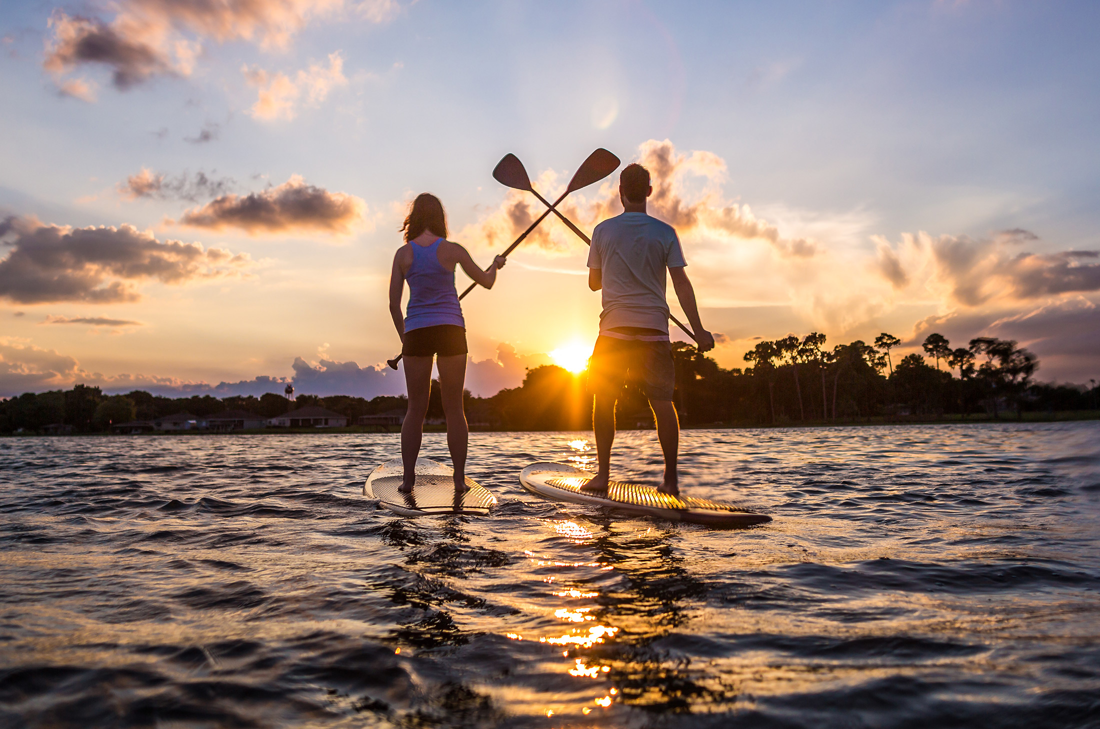WH paddle boarding couple